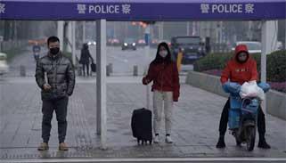 সুস্থদেরও জোরপূর্বক কোয়ারেন্টাইনে পাঠাচ্ছে চীন